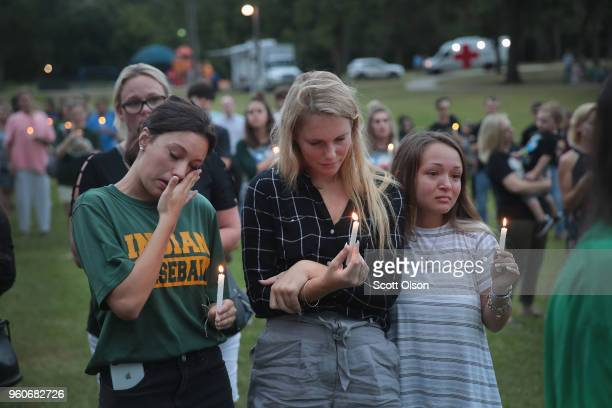 Residents attend a prayer vigil to remember the victims from the Santa Fe High School shooting at Walter Hall Park on May 20 2018 in League City...