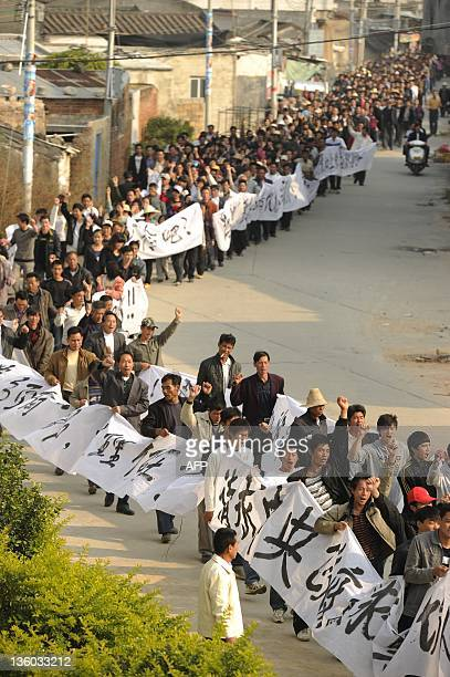 Residents attend a rally in Wukan a fishing village in the southern province of Guangdong on December 17 2011 Thousands of residents of a village in...
