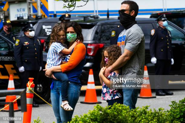 Residents attend the funeral of Glen Ridge Police Officer Charles Roberts after he passed away from the coronavirus on May 14 2020 in Glen Ridge New...