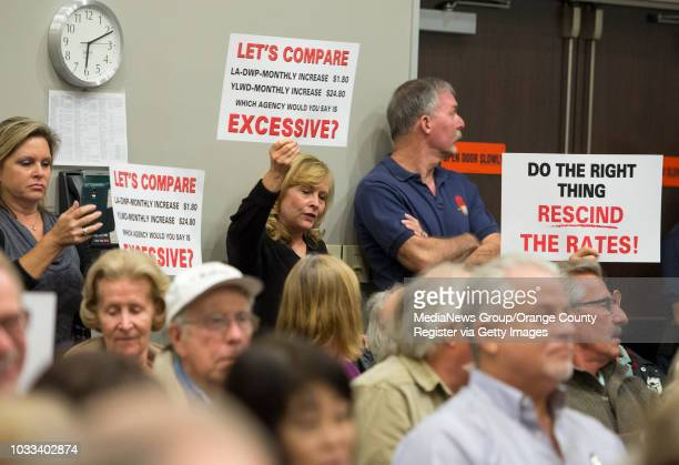 Residents attending the Yorba Linda Water District board meeting hold signs of protest INFORMATION ylwaterdecision Ð 11/5/15 Ð LEONARD ORTIZ ORANGE...