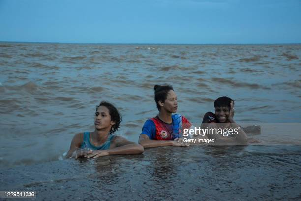 Residents bathe in the Amazon River because of the lack of running water in the city after a blackout due to a fire in the Macapa substation on...