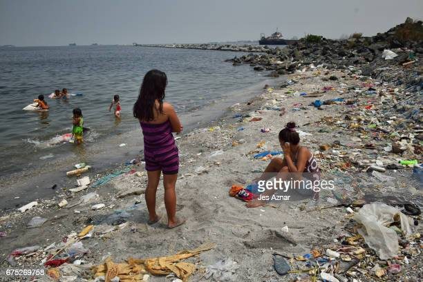 Residents bathe in the polluted waters of Manila bay on April 25 2017 in Manila Philippines Metro Manila has been facing an increasing amount of...