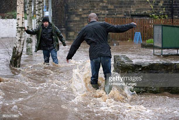 Residents battle against floodwater as the River Calder bursts its bank's in the Calder Valley town of Mytholmroyd on December 26 2015 in Mytholmroyd...
