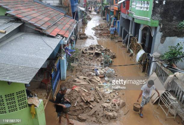 Residents began cleaning mud and furniture affected by floods as high as 5 meters in the residential Pondok gede permai Bekasi West Java January2020...