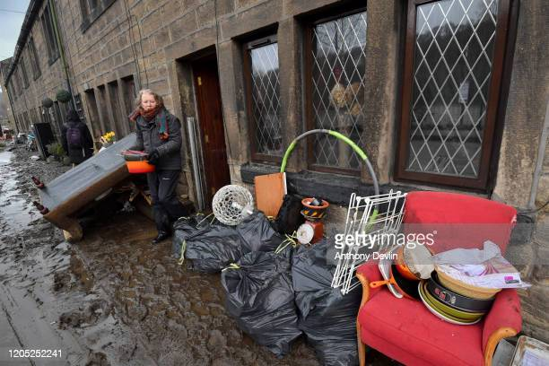 Residents begin clearing up following severe flooding beside the River Calder on February 10 2020 in Mytholmroyd West Yorkshire England