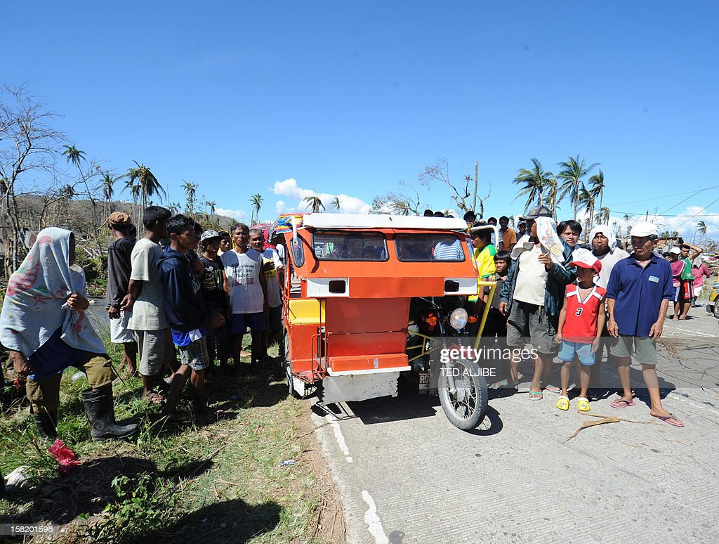 Residents block a highway as they wait for relief goods in Cateel town, Davao Oriental province on December 11, 2012. The United Nations launched a 65 million USD global appeal on December 10 to help desperate survivors of a typhoon that killed more than 600 people and affected millions in the southern Philippines.