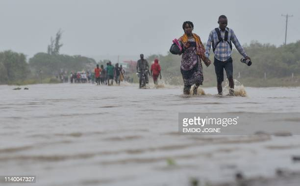 Residents brave the floods in Mazive southern Mozambique on April 28 2019 Heavy rains from a powerful cyclone lashed northern Mozambique on April 27...