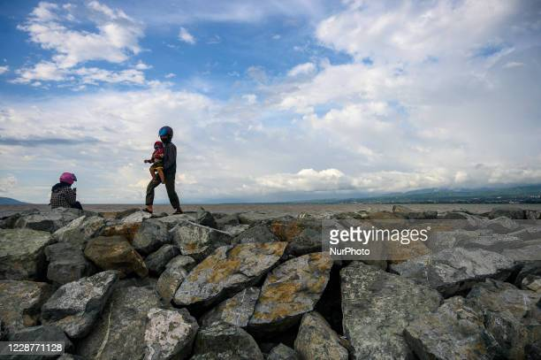 Residents brought their family members to the former tsunami site on Talise Beach, Palu, Central Sulawesi Province, Indonesia on September 28, 2020....