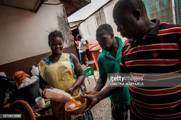 Residents buy pito at a joint in Tema Accra on December 12 2018 The price for this local handmade drink is 45 Ghanaian Cedi the equivalent of around...