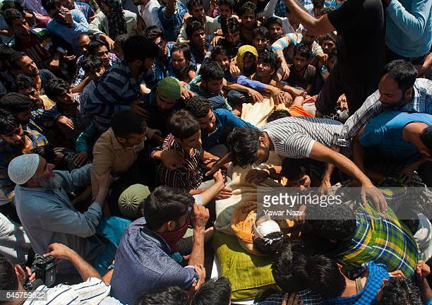 Residents carry the body of Burhan Muzzafar Wani on July 9 2016 in Tral south of Srinagar the summer capital of Indian Administered Kashmir Eight...