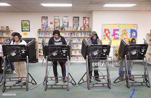 Residents cast their votes at a polling place on November 4 2014 near Ferguson Missouri In last Aprils election only 1484 of Ferguson's 12096...