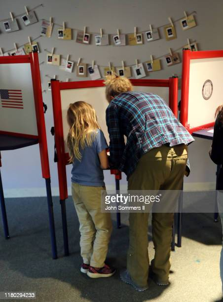 Residents cast votes at St Paul Methodist Church November 5 2019 in Louisville Kentucky Gov Matt Bevin a strong ally of President Donald Trump faces...