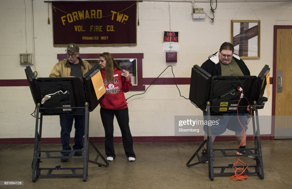Residents cast votes at the Forward Township Volunteer Fire Department polling location in Forward Township, Pennsylvania, U.S., on March 13, 2018. Democrat Conor Lamb and Republican Rick Saccone are competing in the 18th District, where President Donald Trump won by almost 20 points in the 2016 presidential election, to replace Republican Tim Murphy who resigned last October amid personal scandal. Photographer: Ty Wright/Bloomberg via Getty Images