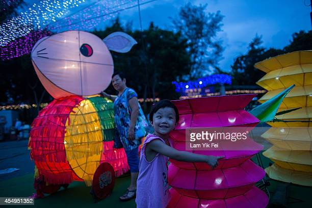 Residents celebrate the lantern festival as part of the Mid-Autumn Festival at Victoria Park in Hong Kong on September 8, 2014 in Hong Kong, China....