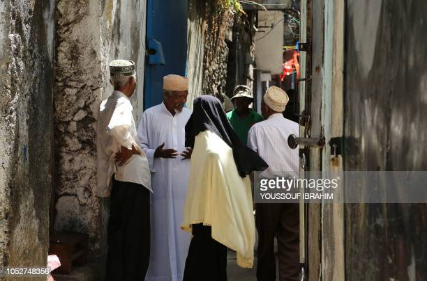 Residents chat among themselves in the narrow streets of the Medina of Mutsamudu on October 22 2018 on the Comoros island of Anjouan Residents on the...