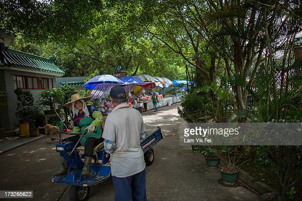 Residents chat in Ping Che Village on July 11 2013 in Hong Kong China The North East New Territories New Development Areas project proposed by HKSAR...