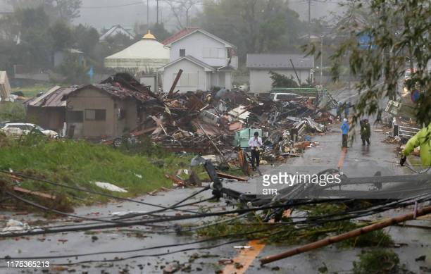 Residents check on homes damaged by strong winds brought by Typhoon Hagibis in Ichihara Chiba prefecture on October 12 2019 Powerful Typhoon Hagibis...