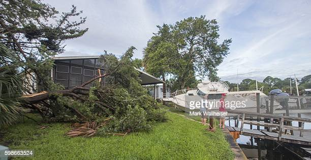 Residents check the damage in their neighborhood after Hurricane Hermaine came ashore on September 2 2016 in Shell Point Beach Florida Hermine made...