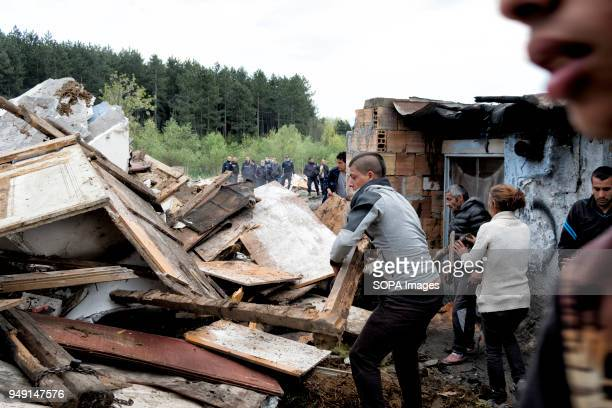 Residents clear debris after homes were razed in a Roma quarter of Sofia. At least 20 homes, deemed illegal were destroyed by the local municipality,...