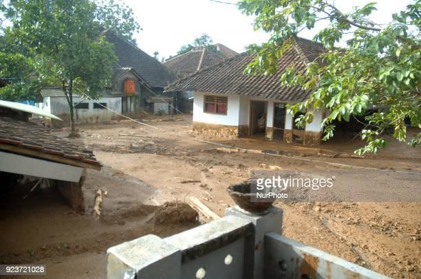 Residents clear roads and save valuables when landslides hit dozens of houses and blocked access roads in Pasir Panjang village Brebes Central Java...