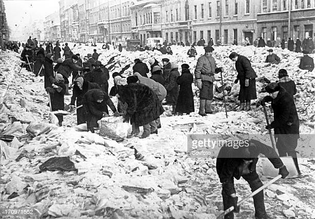 Residents clearing snow and ice from nevsky prospect in leningrad during world war ll 1942