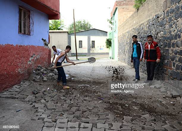Residents close ditches dug by the PKK members as the Turkish Special Operation team carry out an operation against terrorist organization PKK in the...