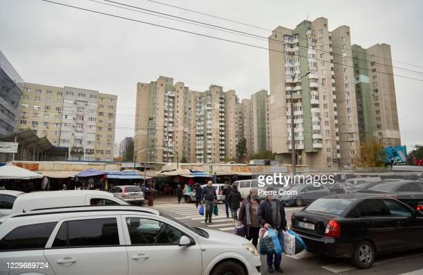 Residents cross a street by a market on November 4, 2020 in Chisinau, Moldova.