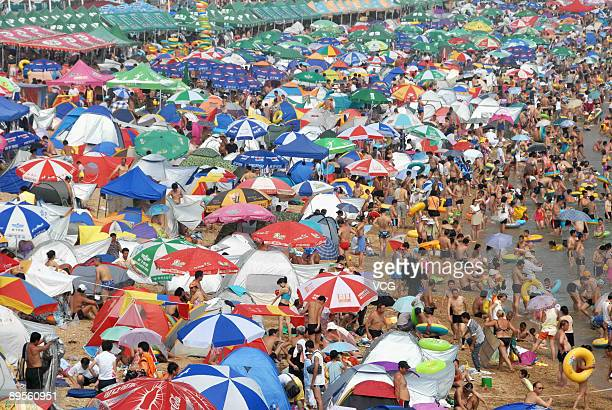 Residents crowd on to the Fujiazhuang beach to cool themselves on August 1 2009 in Dalian of Liaoning province China Over 100000 people visited...