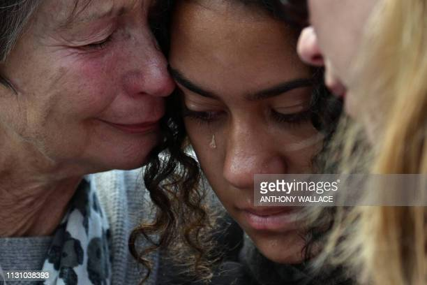 TOPSHOT Residents cry after leaving flowers in tribute to victims in Christchurch on March 17 two days after a shooting incident at two mosques in...