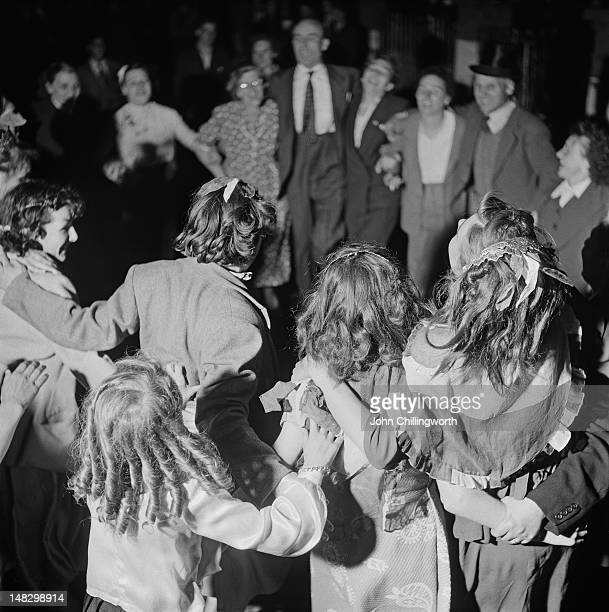 Residents dancing at a party to celebrate the coronation of Queen Elizabeth II held in Morpeth Street in London's East End 2nd June 1953 Original...