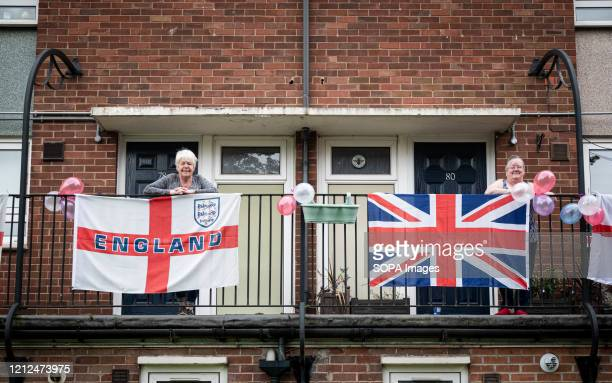 Residents decorate their balconies with flags during the commemoration The VE Day 75th anniversary when Victory in Europe over the Germans was...