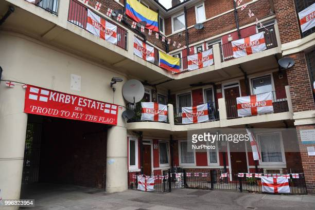 Residents decorate their properties within the Kirby Estate in Bermondsey with St George flags and bunting of show support for England at the FIFA...