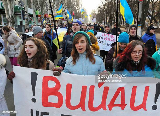 Residents demonstrate calling for solidality after the ceasefire came into effect on February 15 2015 in Sloviansk Ukraine According to its...