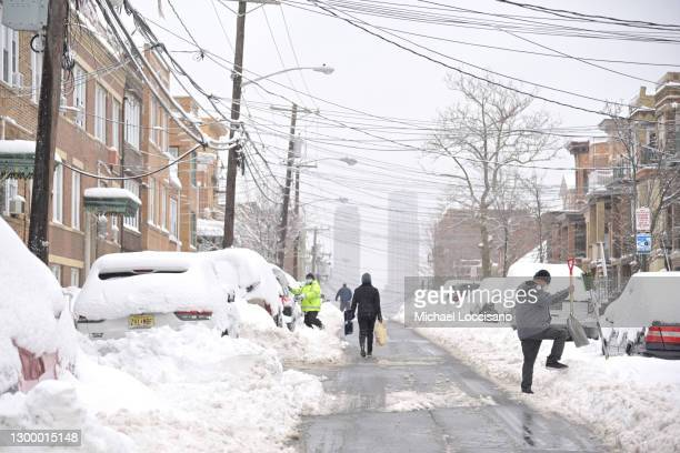 Residents dig their cars out of the snow on February 02, 2021 in West New York, New Jersey. Over two days of snow has covered some parts of New...