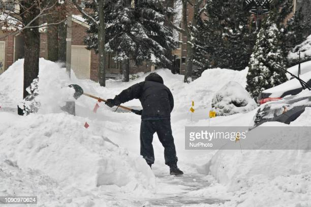 Residents dig themselves out after a massive snowstorm hit Toronto, Ontario, Canada, on January 28, 2019. The storm dropped between 15-25 centimeters...