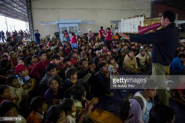 TOPSHOT Residents displaced by massive flood waters from the collapsed dam seek shelter in Paksong town in Champasak province on July 25 2018 The...