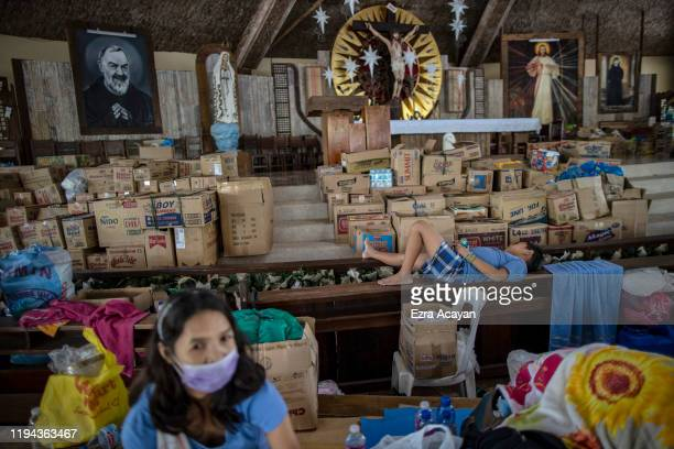Residents displaced by Taal Volcano's ongoing eruption occupy a church turned into an evacuation center on January 18 2020 in Santo Tomas Batangas...
