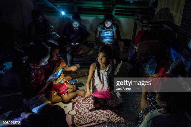Residents displaced by the eruption of Mayon volcano settle inside a public school on January 17 2018 in Legazpi Albay Philippines Thousands evacuate...