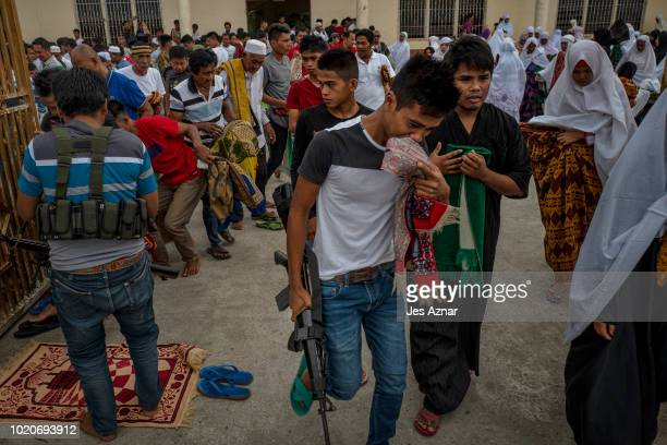 Residents, displaced families, and MILF fighers attend prayer service to celebrate Eid al-Adha on August 21, 2018 in Mamasapano, Central Mindanao,...