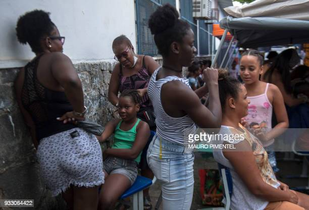 Residents do free haircuts during a social event organized by the Brazilian Armed Forces at Vila Kennedy favela in Rio de Janeiro Brazil on March 17...