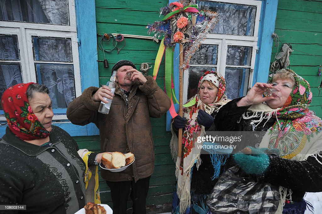 Residents drink vodka during traditional 'Koliady' rituals in the village of Pogost, some 250 km south-east of Minsk, on January 7, 2011. Koliady is an ancient pagan holiday initially celebrated on winter solstice but since appropriated to celebrate Christmas, New Year according to the Julian calendar, and other winter holidays.