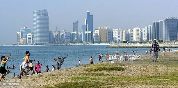Residents enjoy a day at the beach along the corniche in Abu Dhabi 29 January 2007 Abu Dhabi looking to tap into the thriving tourism market in the...