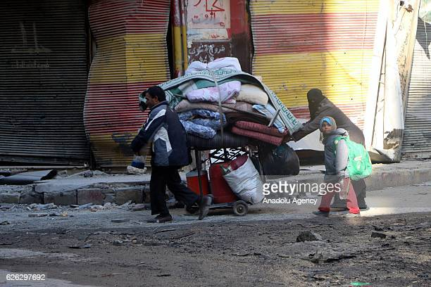 Residents escape from the scene of the air strikes carried out by the war crafts belonging to Russia and Assad regime forces in alShear neighbourhood...