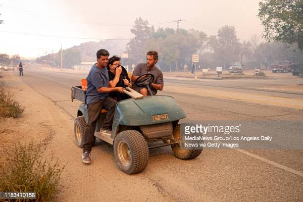 Residents evacuate along Sierra Highway in Canyon Country in the Tick fire in Canyon Country CA October 24 2019