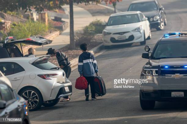 Residents evacuate as the Easy Fire approaches on October 30 2019 near Simi Valley California The National Weather Service issued a rare extreme red...