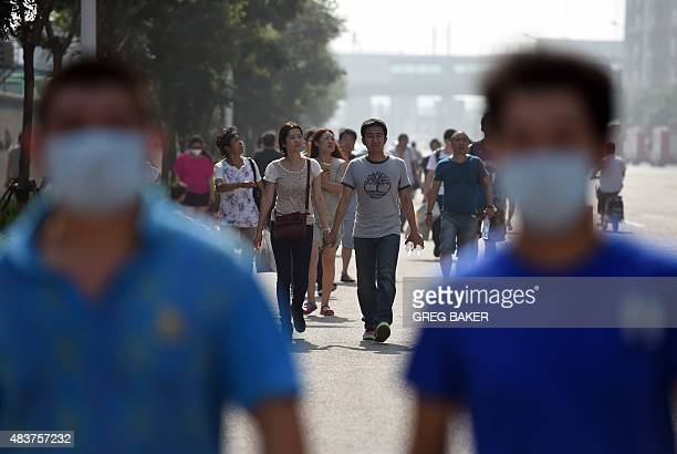Residents evacuate from a residential area near the site of a series of explosions in Tianjin northern China on August 13 2015 A series of massive...
