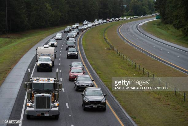 Residents evacuate from coastal areas near Wallace North Carolina on September 11 2018 Hurricane Florence would deliver a direct hit to the US East...