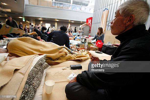 Residents evacuated from areas within around 20 kilometers of the Fukushima Dai-Ichi nuclear plant take shelter at an evacuation center in Koriyama...