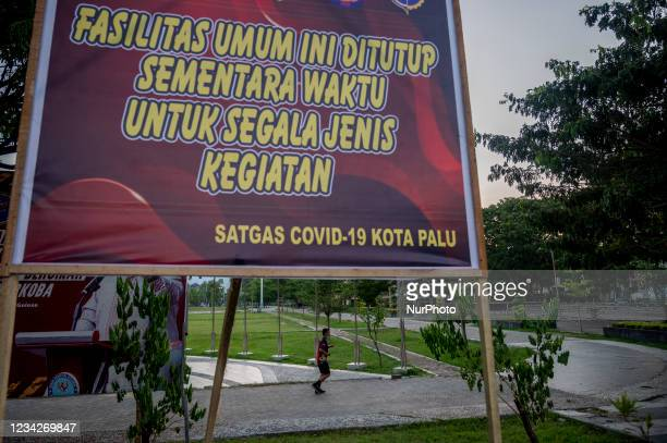 Residents exercise at a public facility at Vatulemo Field, Palu City, Central Sulawesi Province, Indonesia on July 28, 2021. To reduce the spread of...