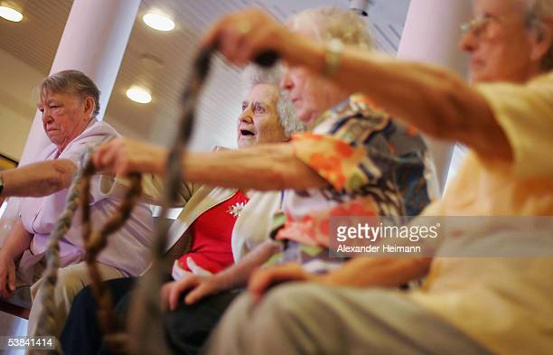 Residents exercise in an elderly home August 31 2005 in Buerstadt Germany Germany's economy and pension system is being burdened by an expanding...